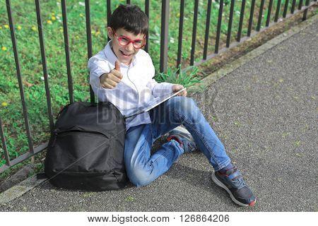 Happy boy sitting on the ground