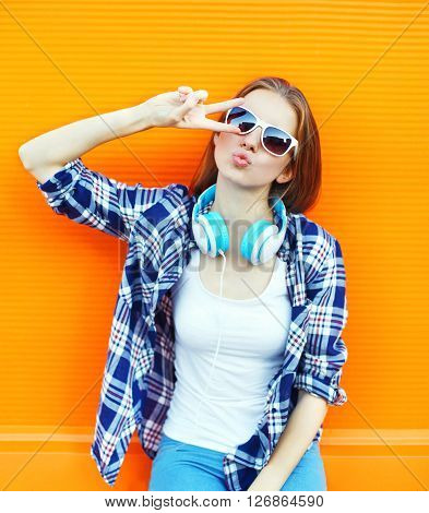 Cool Girl Having Fun Listens Music In Headphones Over Colorful Background