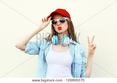 Pretty Cool Woman In Sunglasses And Red Cap Over White Background