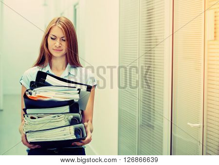 Woman In Office With Documents Portrait