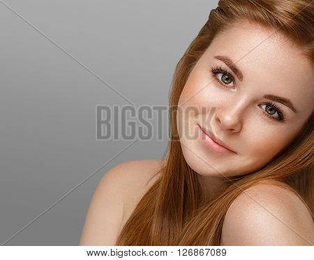 Beautiful Woman Face Close Up Portrait Young With Red Hair On Gray Background