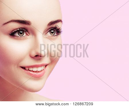 Beautiful Fashion Woman Face Close Up Portrait Young  On Pink.