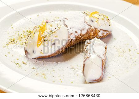 close up of delicious sicilian cannoli dessert