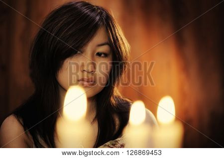 Portrait of asian woman with candles