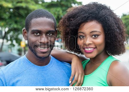 Laughing african american couple outdoor in the city