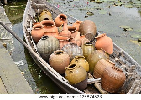 Old  brown Earthenware in old wooden boat
