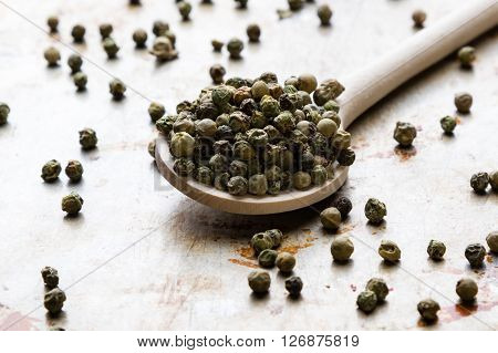Green Peppercorn Seeds On Steel Plate