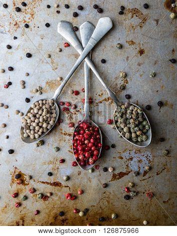 Peppercorn Seeds On Vintage Spoons