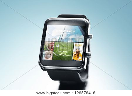 modern technology, mass media, object and media concept - close up of black smart watch with news application on screen over blue background
