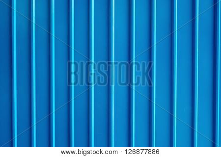 Seamless abstract background blue aluminium metal plate texture with vertical lines pattern.