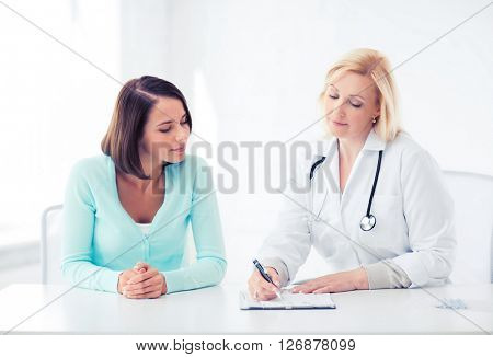 healthcare and medical concept - doctor with patient in hospital