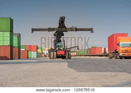Front Cranes Or Forklift Working With Container
