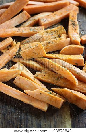 Fresh Cut Slices Of Sweet Potatoes Made Into Fries, Ready For Cooking