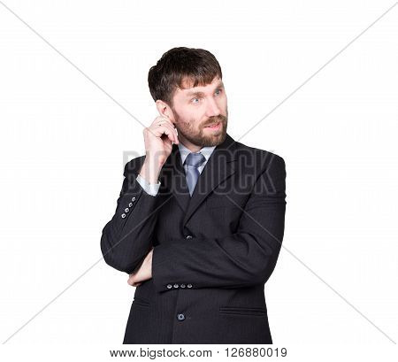 gestures distrust lies. body language. man in business suit, scratching, rubbing the ear. isolated on white background. concept of true or false.