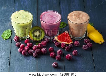 Glasses of homemade smoothie with grapefruit kiwi cherry and mint leaves . Conception of healthy food. Nonalcoholic drinks.