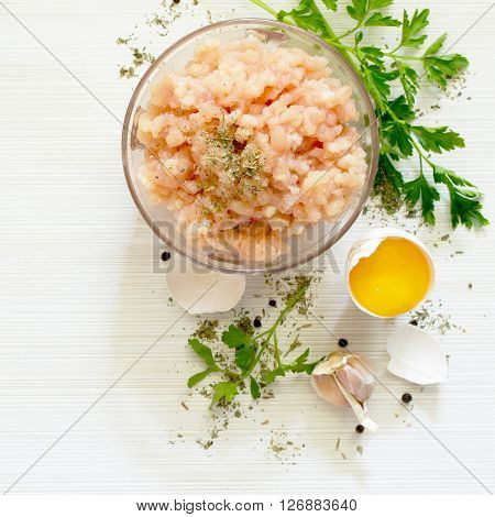 Healthy Food Background, Raw Minced Meat, Egg Yolk And Various Spices On A Wooden Table.