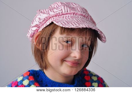 Portrait of the girl - teenager. On his head wearing a cap.