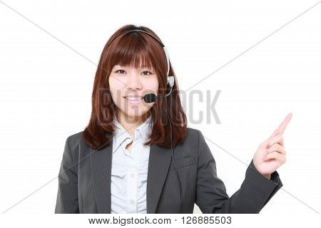 young Japanese woman presenting and showing something