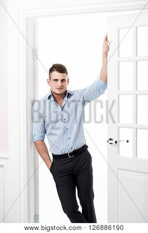 Portrait of a well built muscular male model against light background