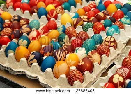 many various colorful easter eggs in eggboxes Serbia