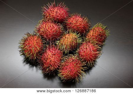 Rambutans with Skins on Warm Seamless Background