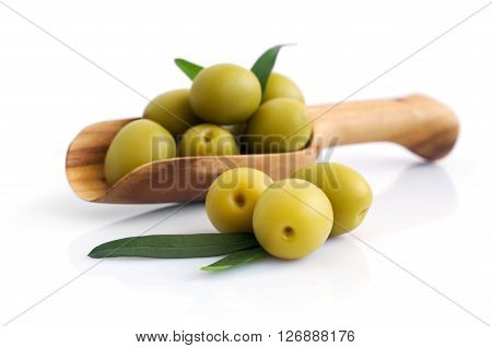 Green Olives In Wooden Scoop