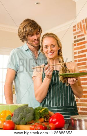 Cute couple cooking in the kitchen