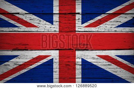 United Kingdom grunge wood background with UK flag painted on aged wooden wall.