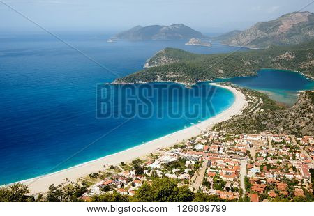 Town and beach on a coast of mediterranean sea. Oludeniz Fethiye Turkey.