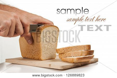 bread with a knife on a cutting board isolated on a white background