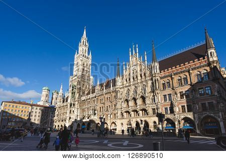 Munich Germany - January 08 2016: People walk in the shadow of Cityhall building located in Marienplatz square of Munich