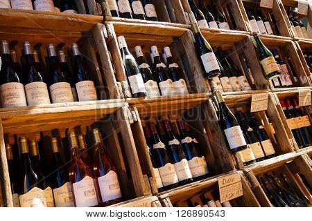 Munich Germany - January 08 2016: Bottles of wine in the Viktualienmarkt famous food market in the center of Munich