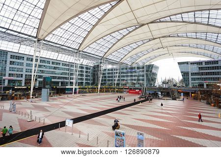 Munich Germany - January 08 2016: People in modern glass interior of Munich airport
