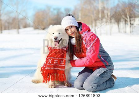 Woman Owner With White Samoyed Dog Together On Snow In Winter Day