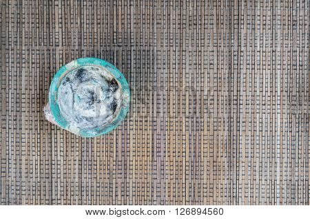 Empthy ashtray on brown woven cloths on the left side