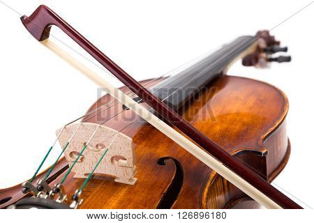 Back View Of A Violin With Bow On Strings