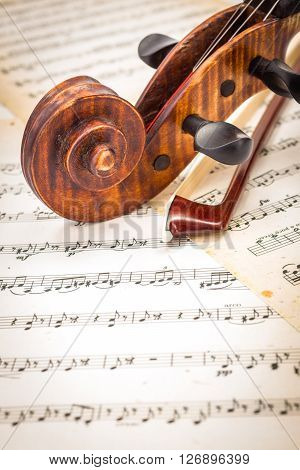 Close View Of Violin Scroll And Bow