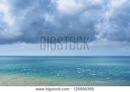 View Of Strait Of Dover (pas De Calais) With Dramatic Clouds And A Yacht Sailing