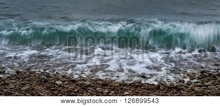 Green Wave Tide On A Beach In Etretat, France