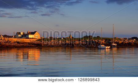 Sunset sea view of yachts and boats in Lilia bay in Brittany France