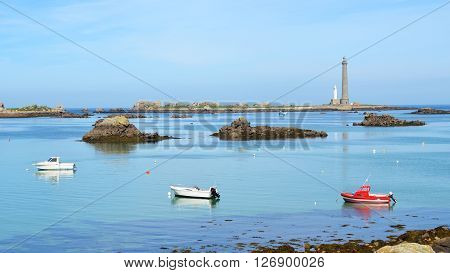 View Of Île Vierge Lighthouse, Several Boats And The Sea Coast In Brittany, France
