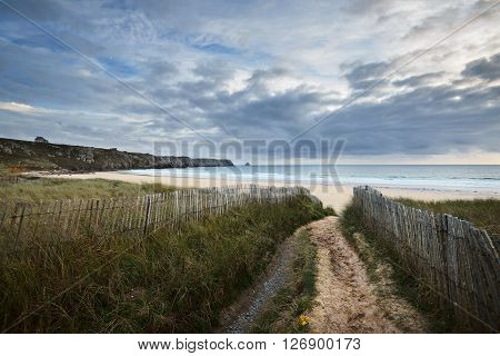 Sandy Footpath Leading To Ocean Coastline Through Green Grass Pointe De Toulinguet In Brittany, Fran