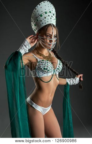 Dancing for adults. Sexy stripper posing in erotic costume