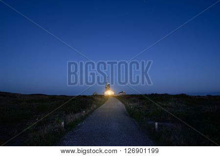 Meteorological station and a lighhouse by night at Pointe du Raz in Brittany France