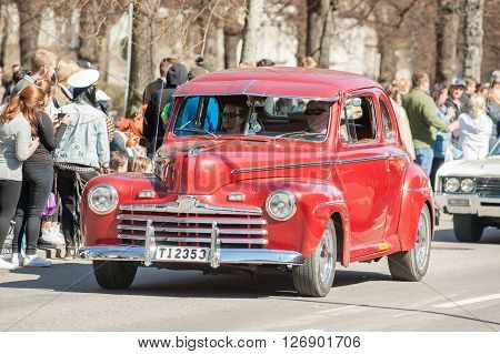NORRKOPING, SWEDEN - MAY 1: Vintage Ford at classic car parade celebrates spring on May 1, 2013 in Norrkoping, Sweden. This parade is an annual tradition in Norrkoping on May Day.