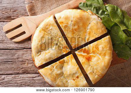 Tasty Sliced Greek Spanakopita Pie Close-up On The Table. Horizontal Top View