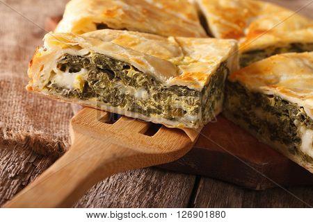 Greek Spanakopita Piece Of Pie Macro. Horizontal