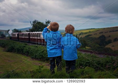 Two Boy, Looking At Old Steam Train