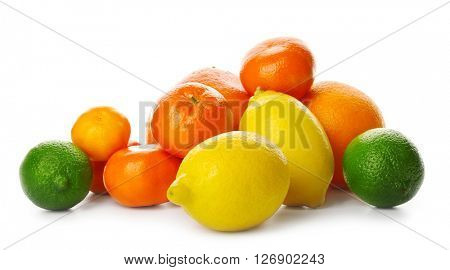 A heap of mixed citrus fruit including   lemons, limes, grapefruit, oranges and tangerines isolated on a white background, close up