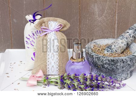 Lavender herbal water in a  bottle, fresh flowers and dry in mortar